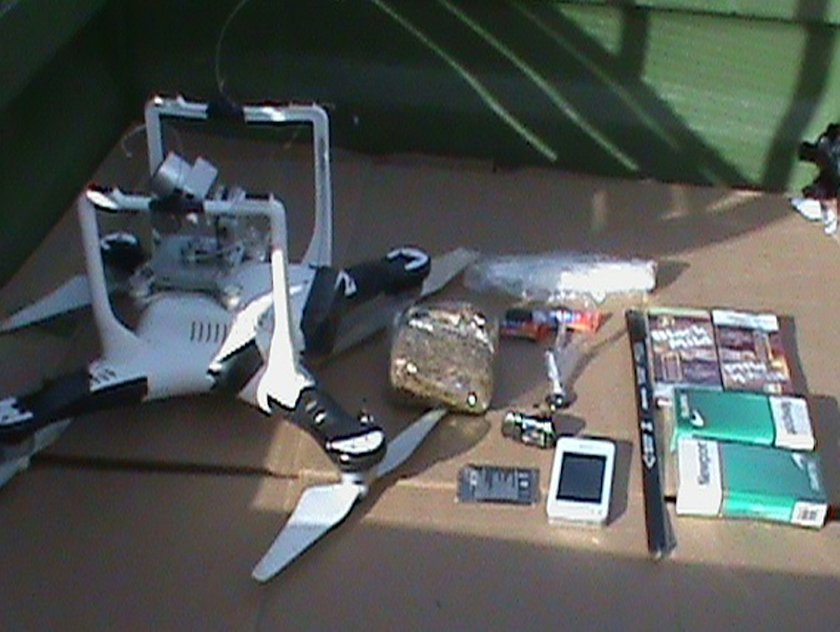 Drone smuggling drugs cell phone guns to prisons.jpg